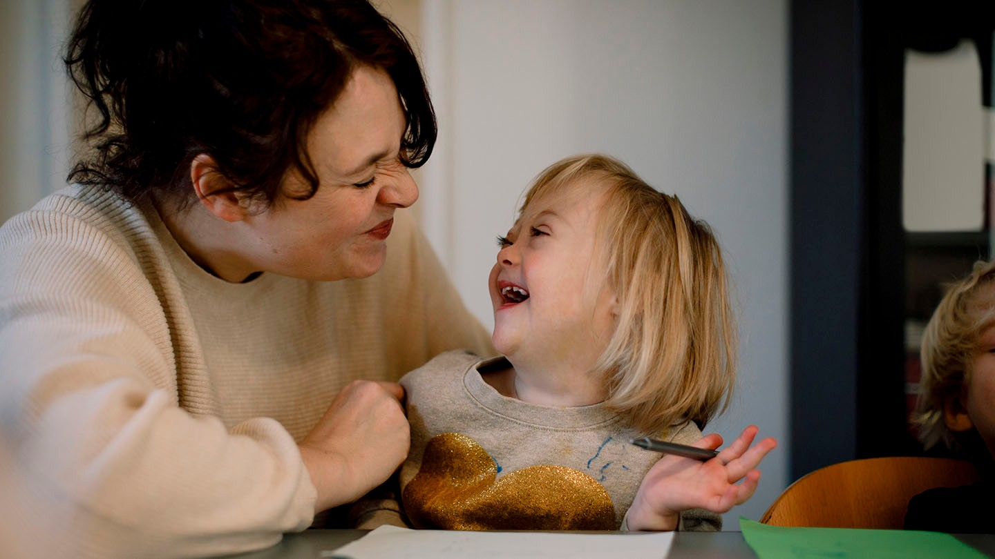 young child with downs syndrome and female adult