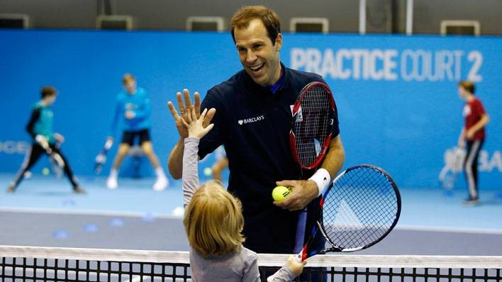 Greg Rusedski and ball kid high five