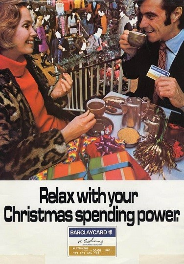 Barclaycard Christmas advert showing a man and a woman drinking coffee with the words 'relax with your Barclaycard'
