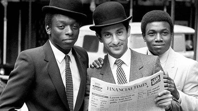 Garth Crooks, Ossie Ardiles and Danny Thomas pose as City gents outside the London Stock Exchange on the club's first day of share dealings