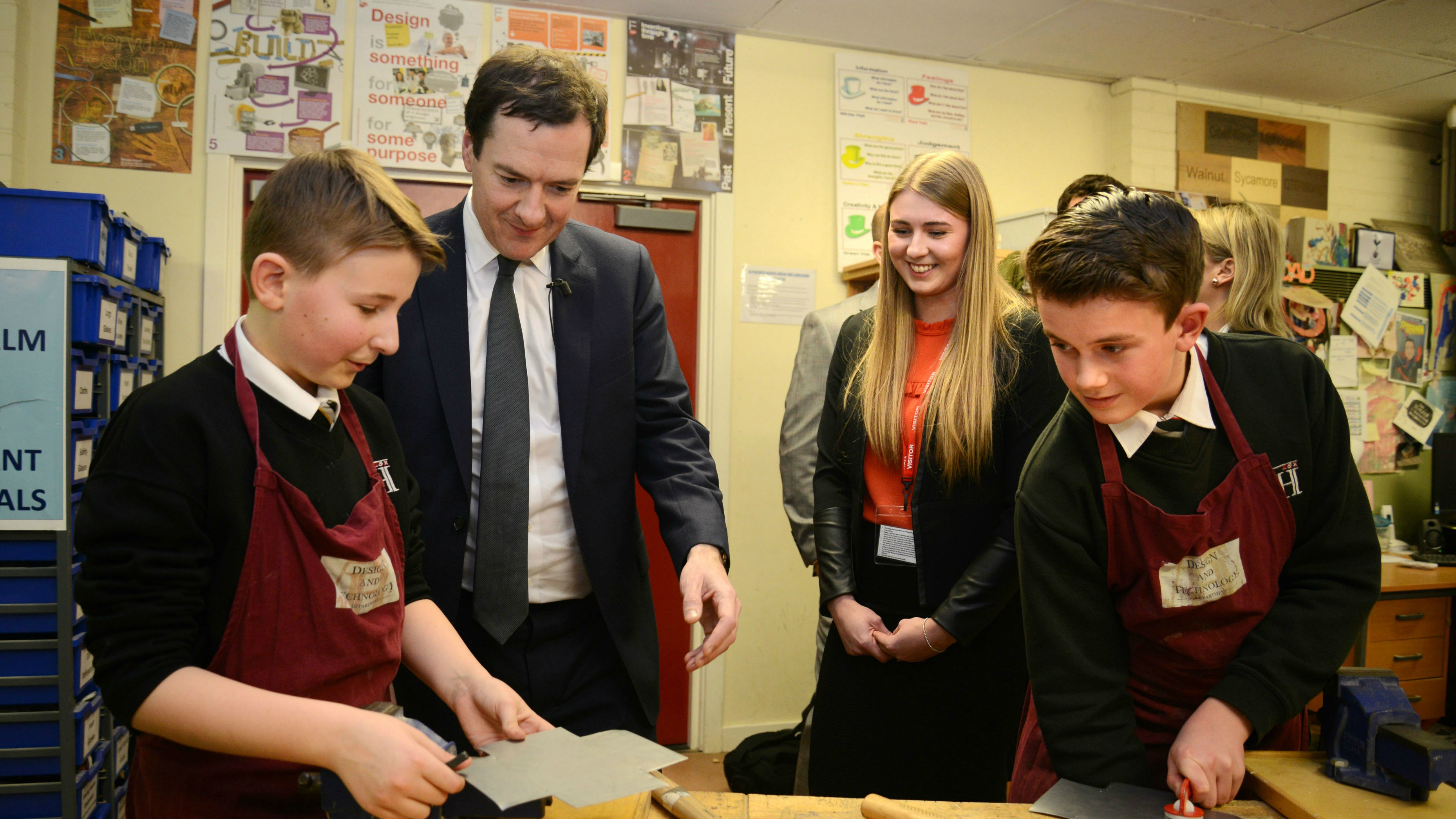 George Osbourne talking to children