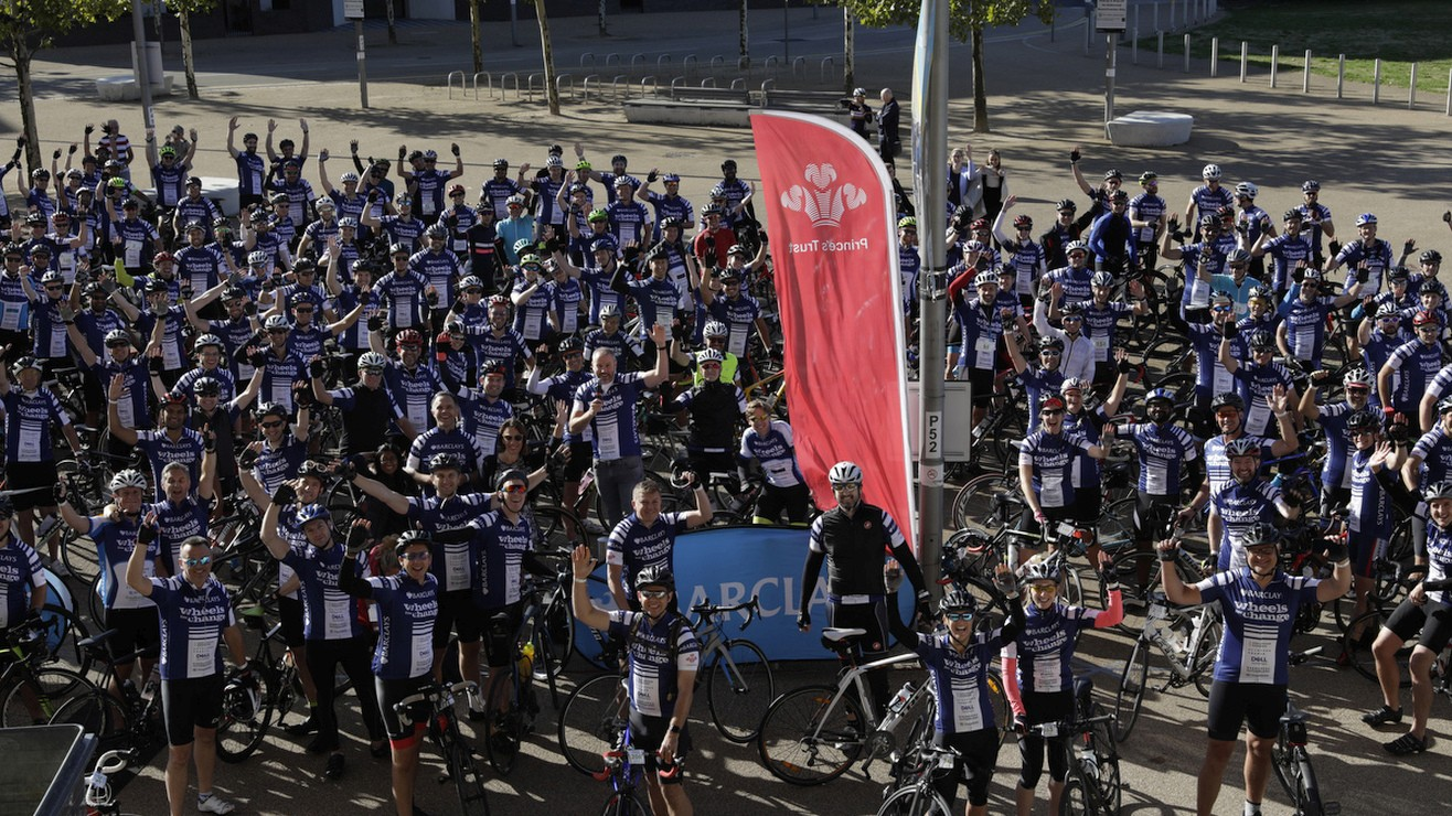 A large group of cyclists celebrate their achievements
