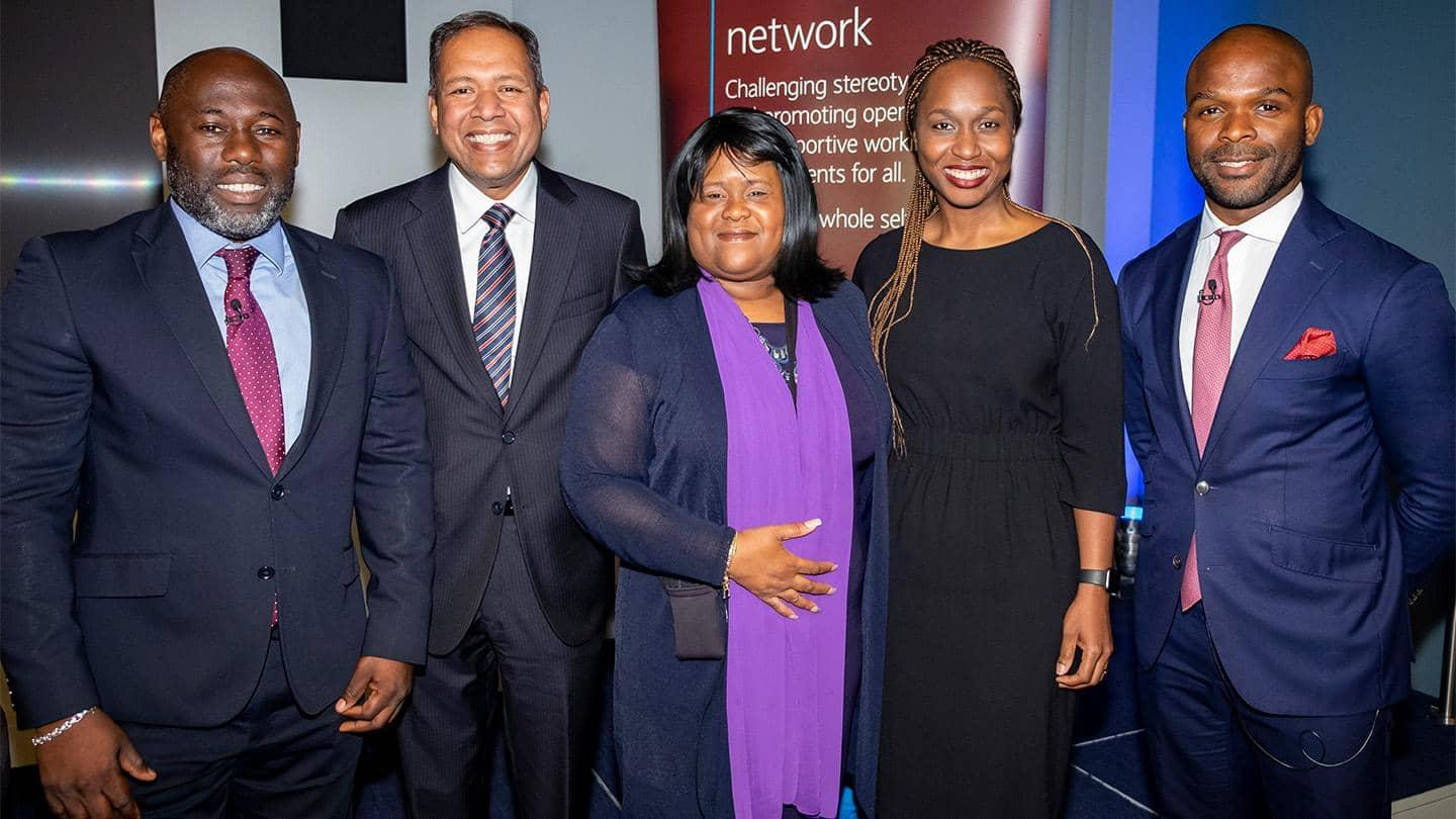 Ken Osivwemu, Sandra Kerr CBE and Kelechi Onukogu joined by Barclays colleagues
