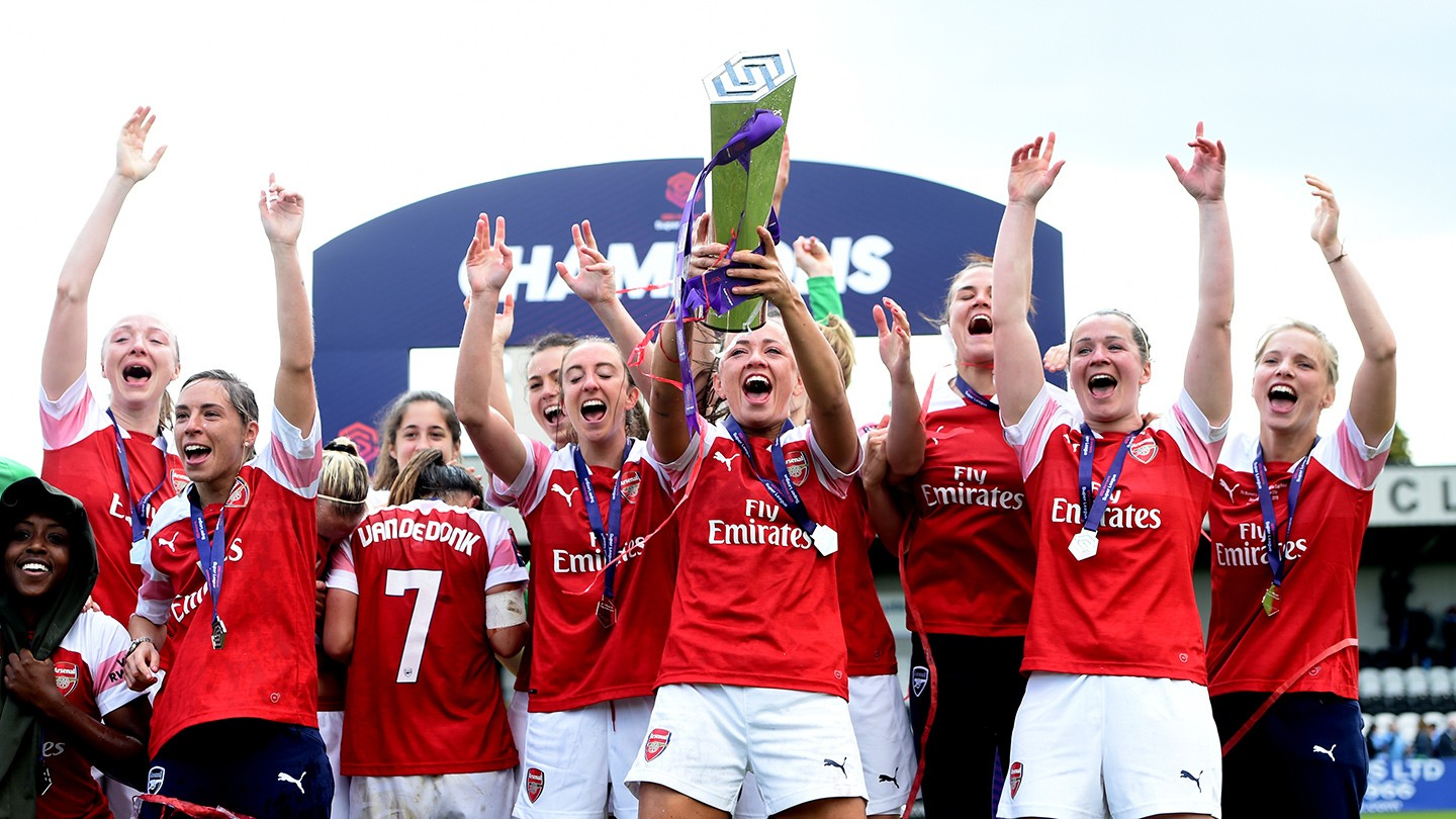 Arsenal  lifting the Women's Super League trophy