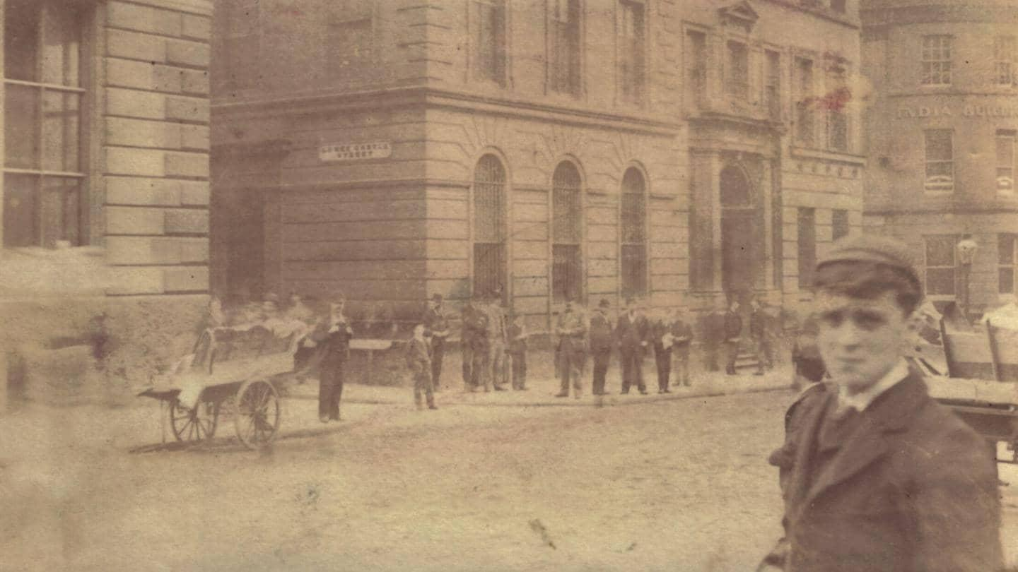 A young Barclays bank out-teller photographed on the streets of Liverpool in 1895.
