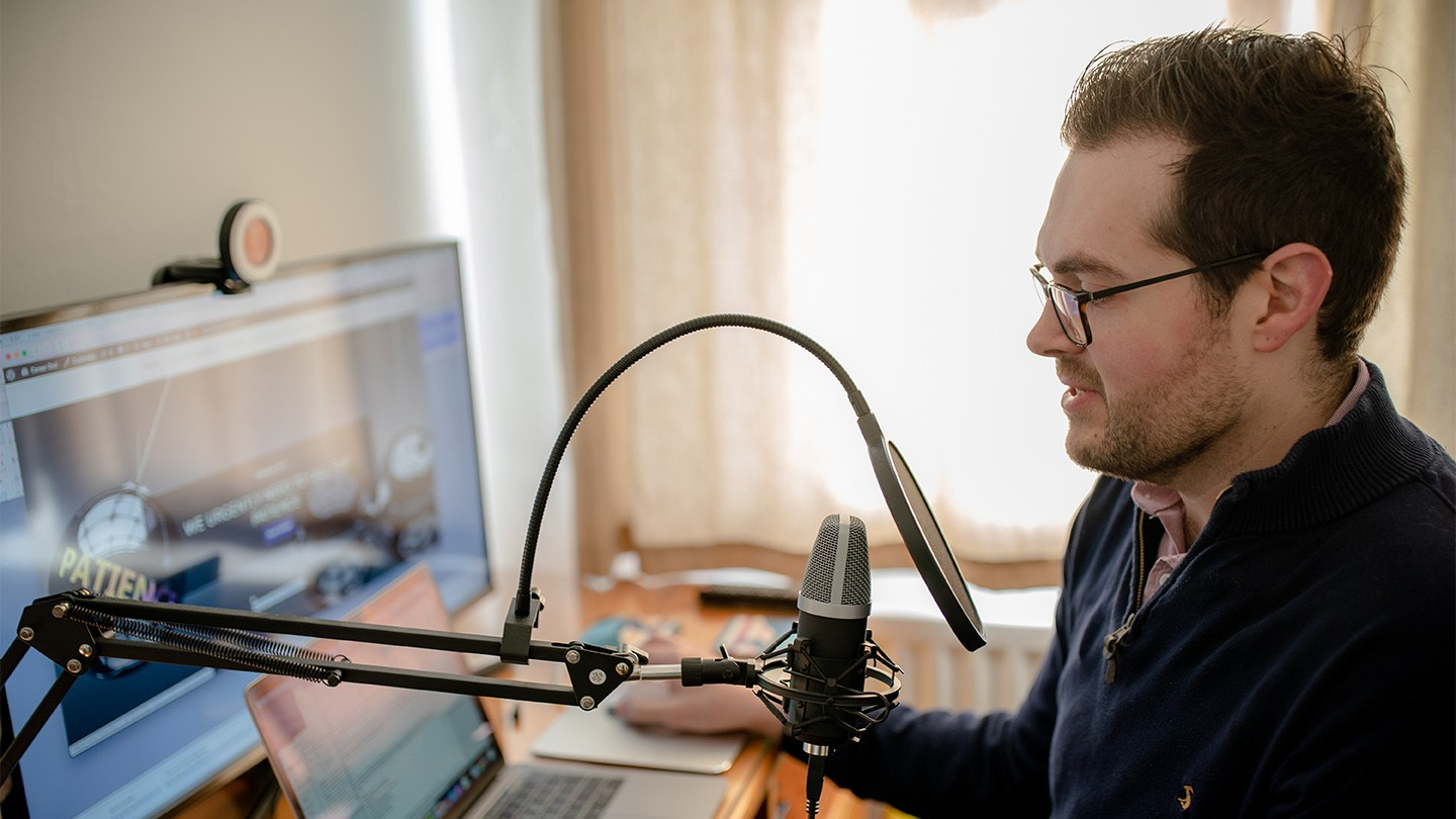 Daniel Reed recording a podcast episode