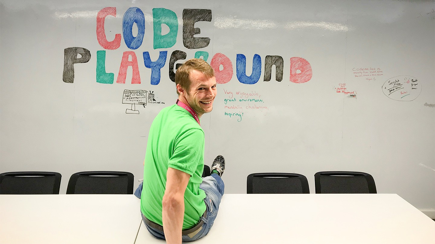 Barclays Head of Code Playground Kevin Garner smiling in a school classroom