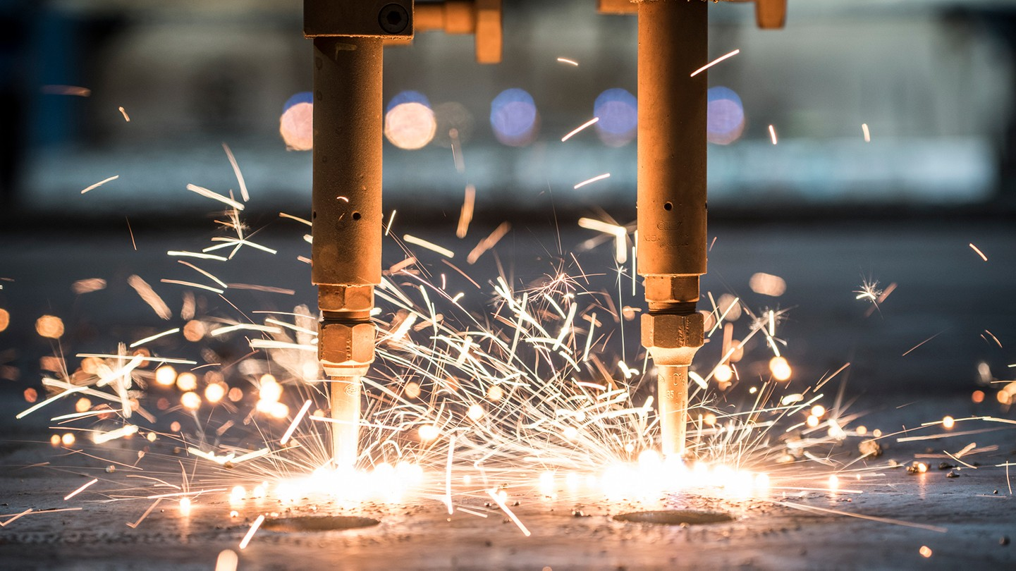 Close up of machinery emitting sparks.