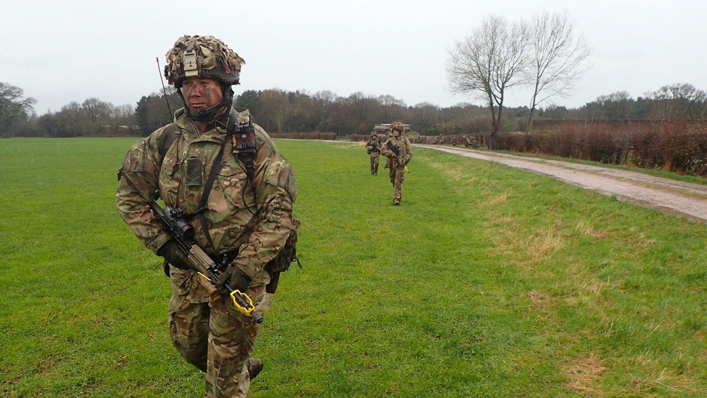 Army reservist Tom Wood running in a field