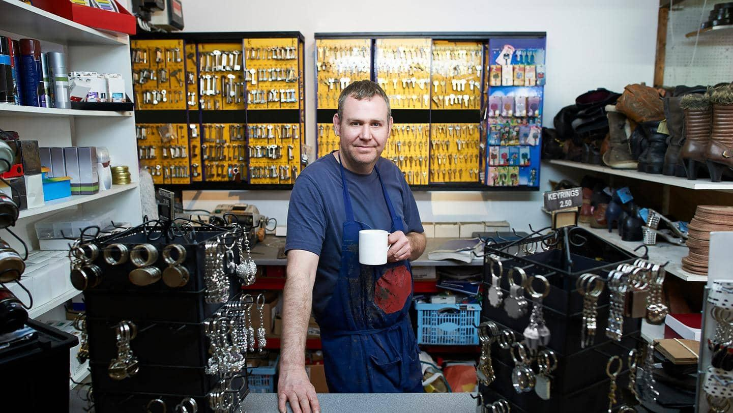 Male shopkeeper in locksmith store.