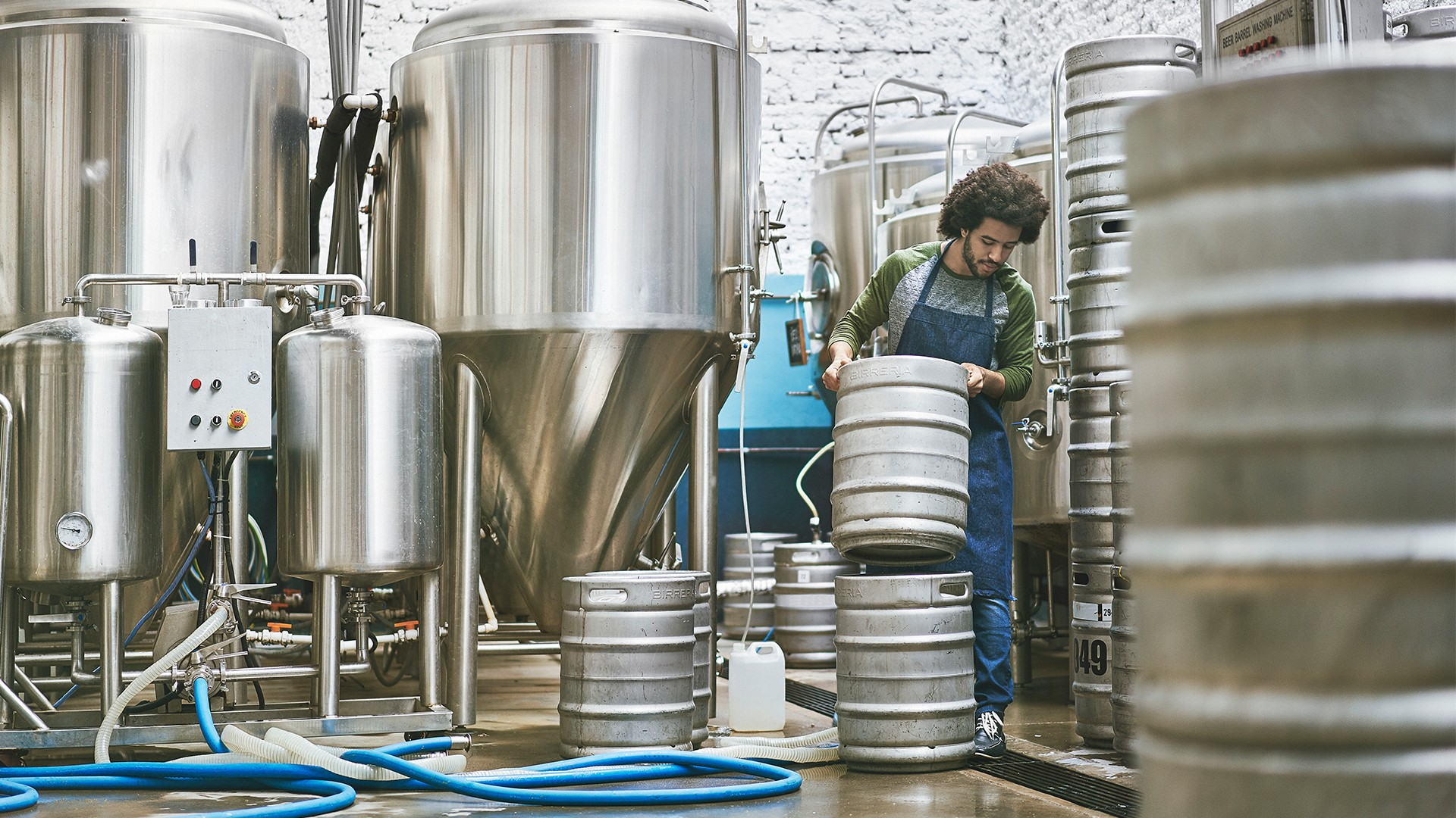 A man working at a brewery