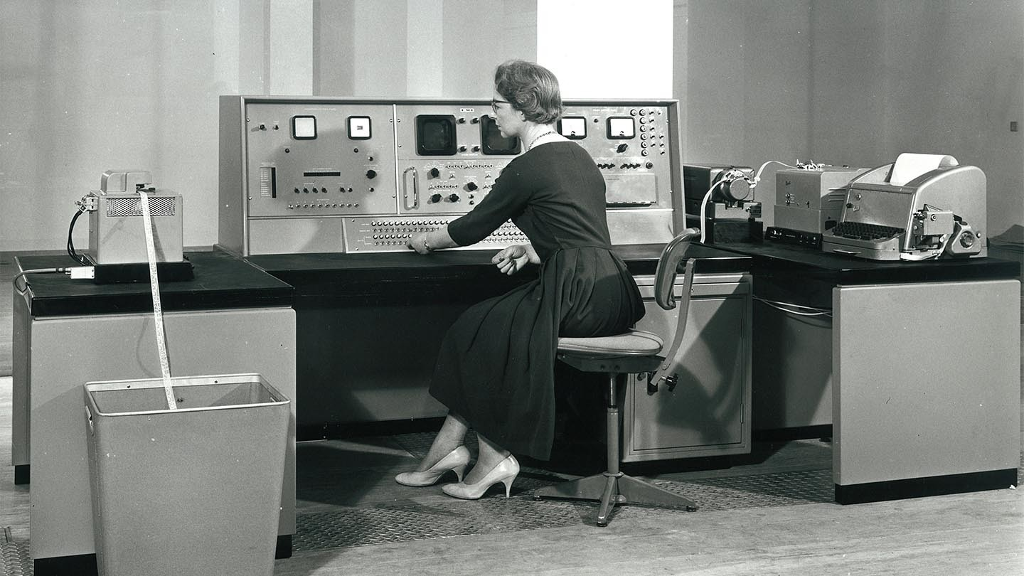 Audrey Stone operates a machine at a computer centre.