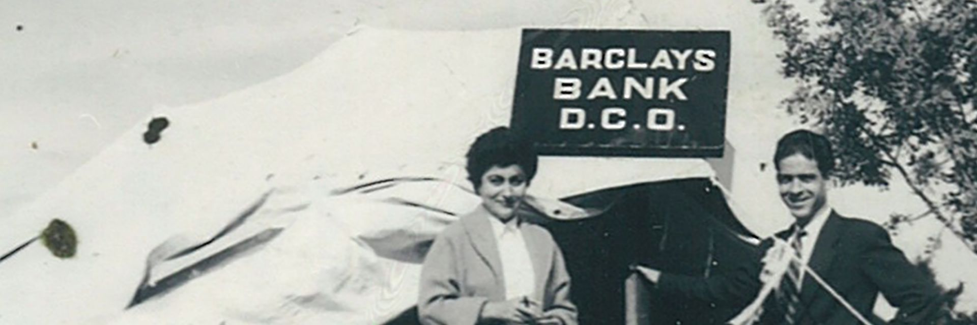 Araxie Yaghlian, Barclays' first female manager, standing outside the tent from which she conducted business in Cyprus.