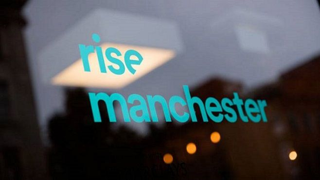 Rise Manchester lettering on glass