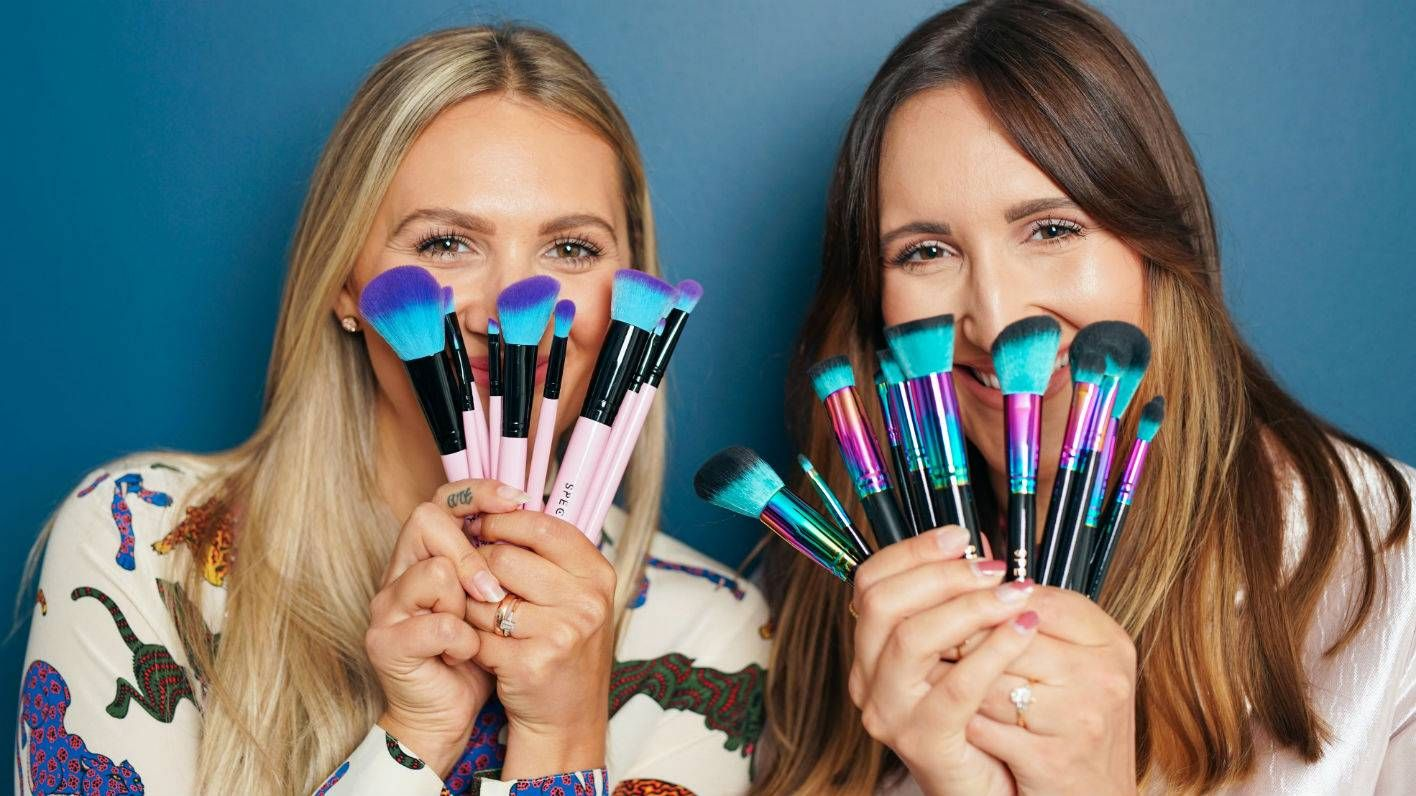 Sophie and Hannah Pycroft holding Spectrum brushes