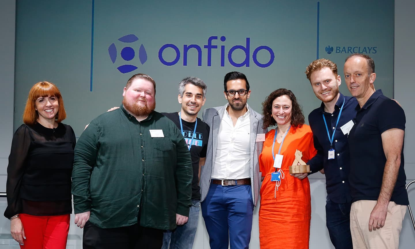 Onfido accepting trophy
