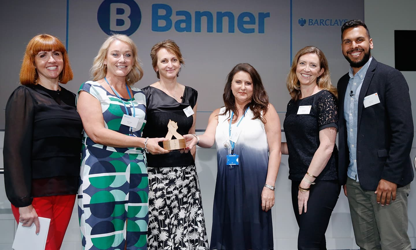 Banner accepting their award