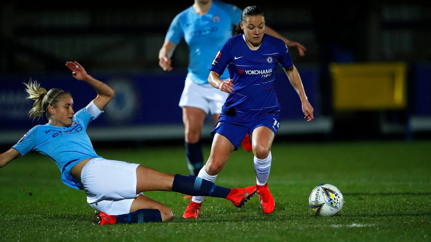 Steph Houghton and Fran Kirby in a match between Manchester City and Chelsea